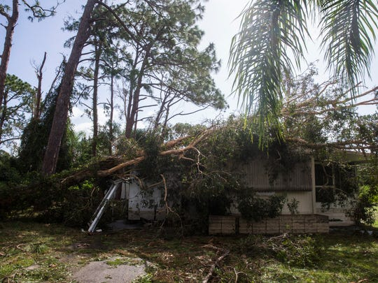 Damage caused by Hurricane Irma on Luttich Lane in Estero on Monday, Sept. 11, 2017.