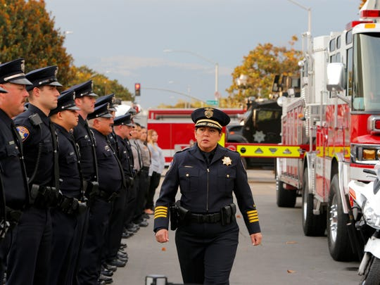 Salinas Police Chief Adele Frese walks in front of the officers during the Sept. 11 ceremony.