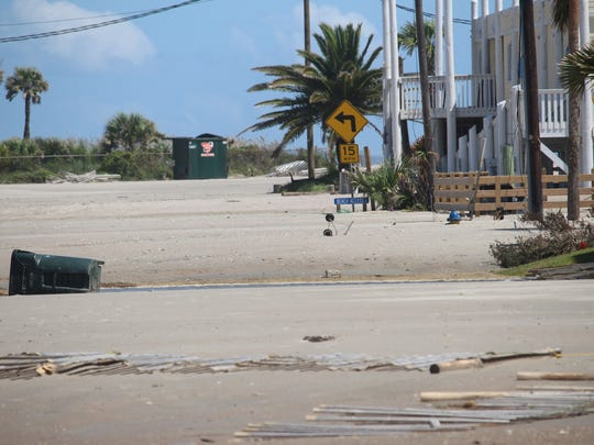 Tidal flooding from Hurricane Irma on Monday left up to 3 feet of sand on the main road in Edisto Beach.