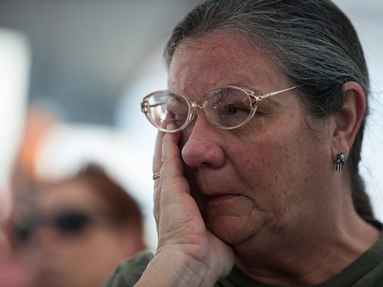 "Rockport resident Vicki Skinner becomes emotional during the play of Phillip Zuniga song ""Walk the Streets of Rockport"" at a Rockport-Fulton town hall meeting on Tuesday, Sept. 12, 2017."