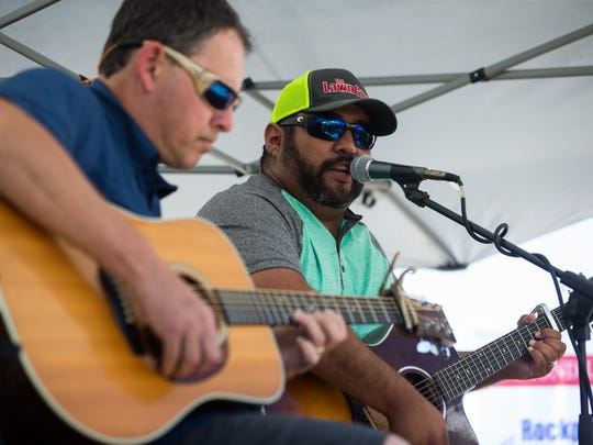"Phillip Zuniga (right) and Scott Simmons perform their song ""Walk the Streets of Rockport"" at a Rockport-Fulton town hall meeting on Tuesday, Sept. 12, 2017."