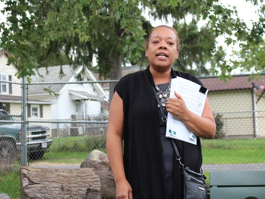 NECIC executive director Deanna West-Torrence discusses the organization's proposed new guiding plan in the Blust Avenue Teaching Garden on Wednesday, Sept. 13, 2017. The plan covers topics from blight elimination to violence reduction.