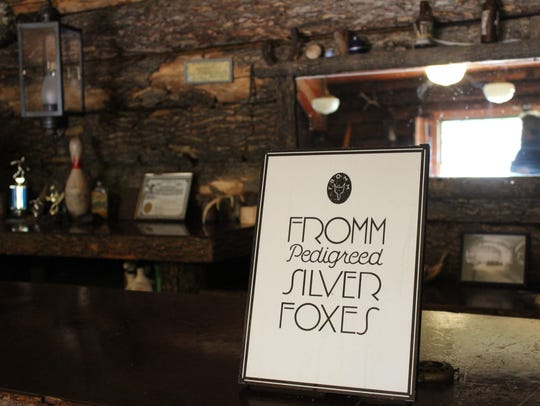A Fromm silver fox poster is displayed on the bar in