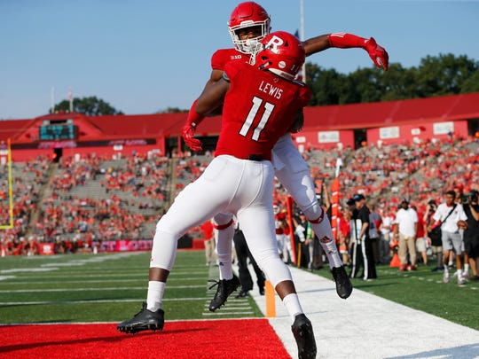Sep 16, 2017; Piscataway, NJ, USA; Rutgers Scarlet Knights quarterback Johnathan Lewis (11) celebrates with wide receiver Bo Melton (18) after scoring a touchdown against the Morgan State Bears during the first half at High Point Solutions Stadium. Mandatory Credit: Noah K. Murray-USA TODAY Sports