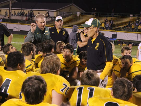 Coach Jerry Sinz (foreground) has Edgar unbeaten and
