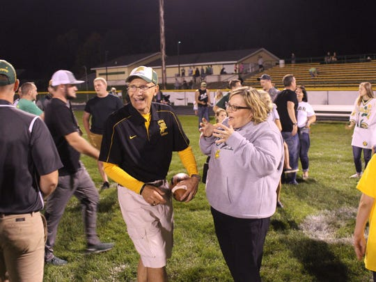 Edgar head football coach Jerry Sinz jokes with a community