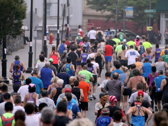 Runners take off from Larkin Plaza in Yonkers at the start of the Yonkers Marathon and half-marathon Sept. 17, 2017.