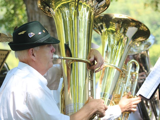 A tuba player with the Smoky Mountain Brass Band sports a traditional German wool hat, called a Tyrolean, during a Sept. 16 performance honoring the 100th anniversary of the WWI internment camp in Hot Springs.