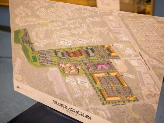 An artists vision of The Crossings at Salem, a large mixed use community that would replace Glasgow Court Trailer Park.