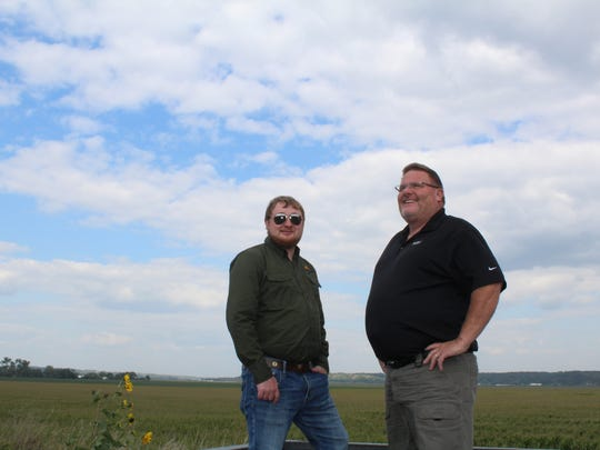 Jeremy Biggs, precision agriculture business planning specialist with Pheasants Forever, and farmer Lee Wisecup discuss converting a portion of the fields behind them into wetlands. Low-lying areas often flooded out crops on Wisecup's farm near Missouri Valley.