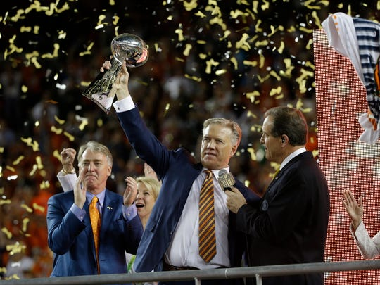 John Elway, General Manager and Executive Vice President of Football Operations for the Denver Broncos holds the championship trophy after the NFL Super Bowl 50 football game Carolina Panthers Sunday, Feb. 7, 2016. It was Elway's third title with Denver, his first two as a Hall of Fame QB.