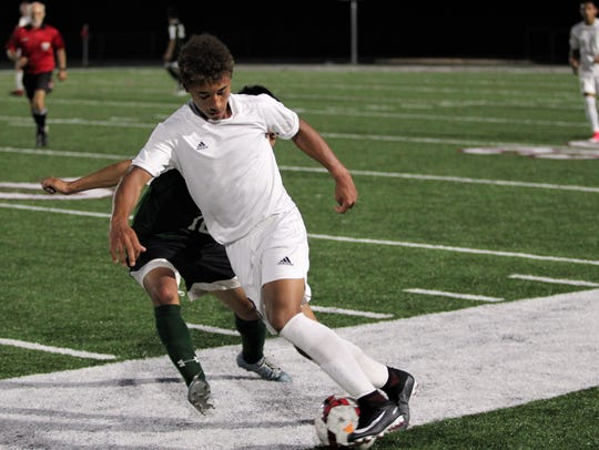 Lorenz Hoover dribbles the ball up the field against
