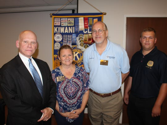 Pictured (from left to right) are: Alan J. Robinson,