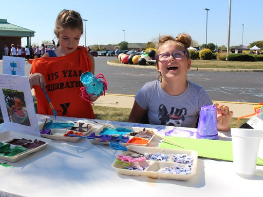 Ava Mathys, 9, of Marion (left) and Natalie Wonders,