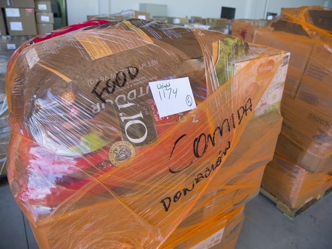 Donation pallets wait to be loaded at Swift Aviation