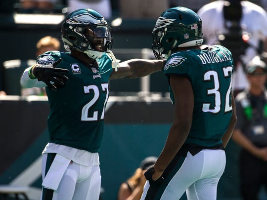 Eagles' Malcolm Jenkins celebrates with Rasul Douglas after Douglas made an interception during their game against the Giants Sunday at Lincoln Financial Field.