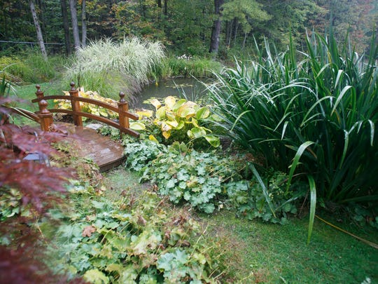 A pond at the home of Earl Butler on Thursday September 14, 2017. Butler constructed a drainage system to create a series of ponds as part of his gardens.