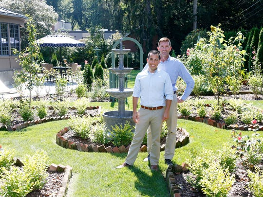 From left, John Welch and Joe Menichello, of Binghamton inside their recently completed parterre garden on Monday September 18, 2017.