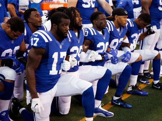 Indianapolis Colts players kneel during the playing of the National Anthem before the game against the Cleveland Browns at Lucas Oil Stadium.