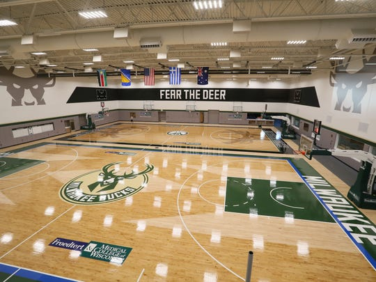 Bucks players John Henson and Malcolm Brogdon credit the new, more cushioned practice court for keeping their bodies feeling fresh after workouts.