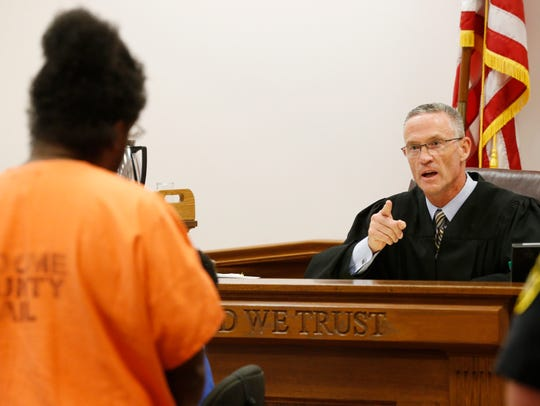 Judge Joseph Cawley speaks to Dwight Burton before