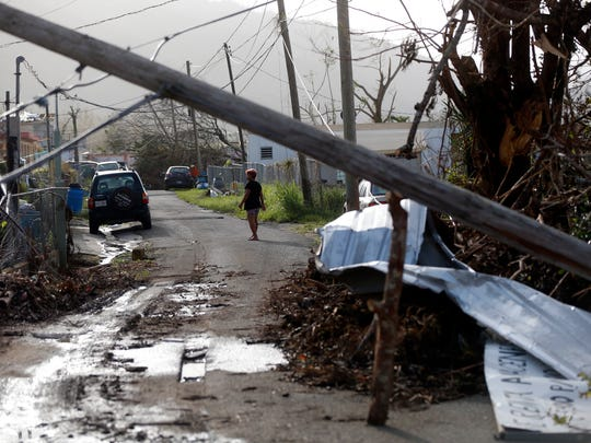Downed paper lines and debris are seen in the aftermath