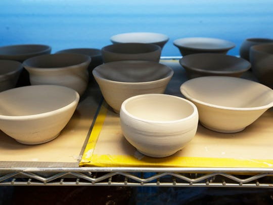 Clay bowls air dry during a ceramics class at WHAM