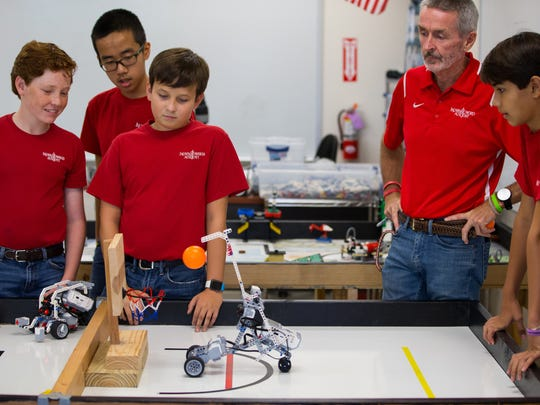 Nikolai Steen test his robot in Robert Ludlow's robotics class at Incarnate Word Academy Middle School on Wednesday, Sept. 27, 2017.