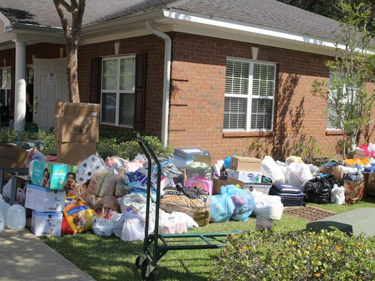 Relief and recovery donations outside the Law Office of Gisela Rodriguez Thursday.