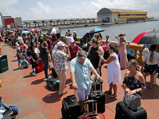 Thousands of people evacuating Puerto Rico line up