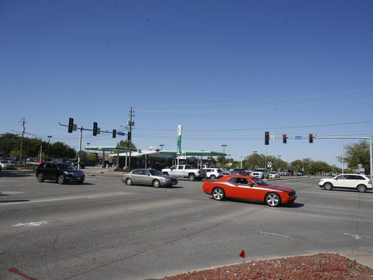 Traffic bustles around the intersection of Ankeny Boulevard