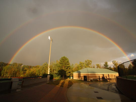 A brilliant double rainbow greeted football fans during Friday's weather delay at Detroit Country Day High School.