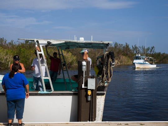 Crabbing boats arrive for the Blessing of the Stone Crab Fleet at the Rod & Gun Club in Everglades City on Saturday, Sept. 30, 2017. The Blessing of the Fleet is a tradition that began centuries ago in Mediterranean fishing communities and is meant to ensure a safe and bountiful season.