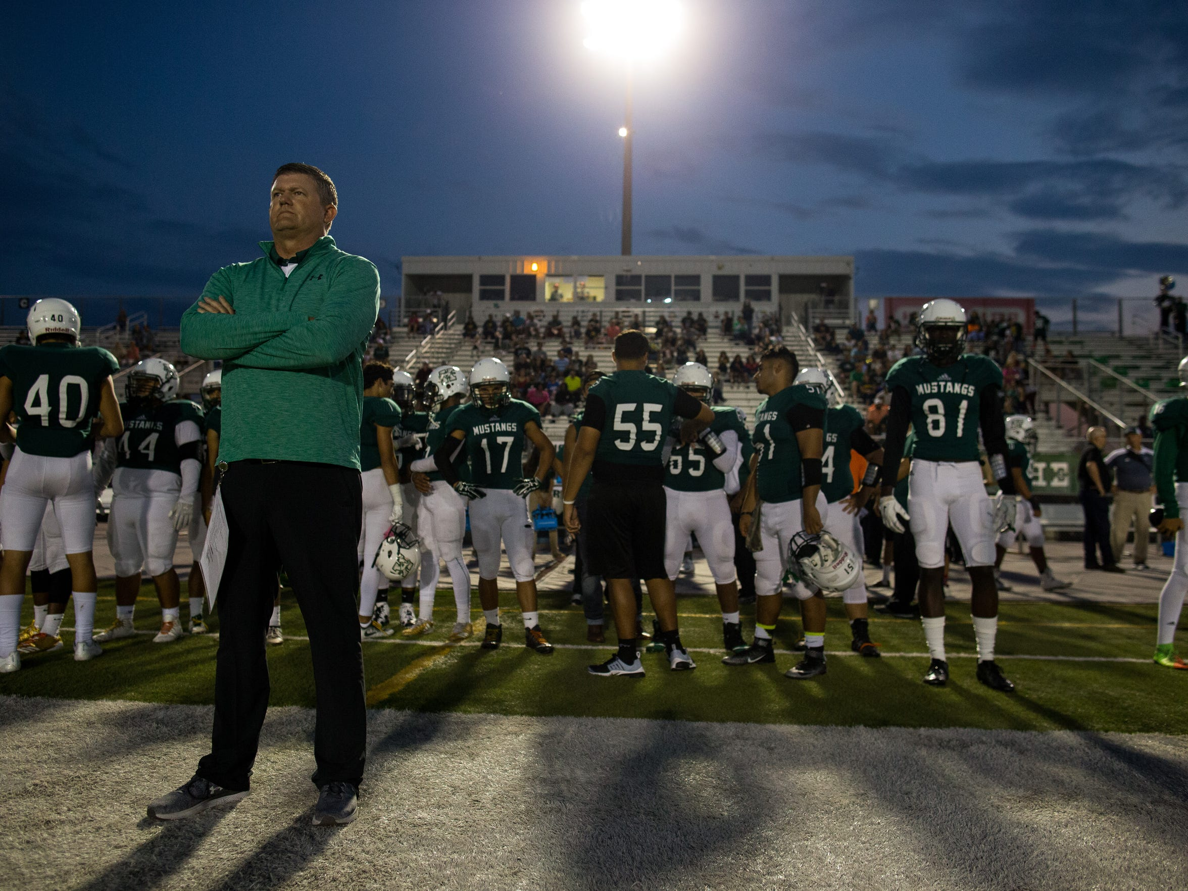 King's head coach Eddie Hesseltine watches from the