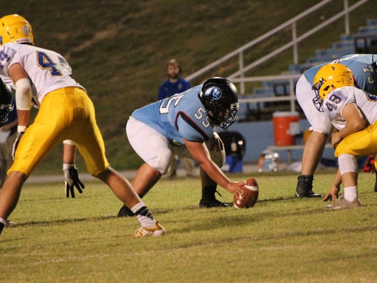 Gage Clements prepares to hike the ball to QB, Jacob Winters.
