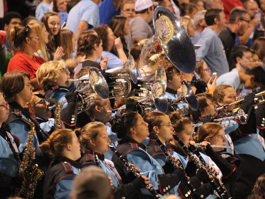 The band performed songs throughout the night in the stands at the football game.