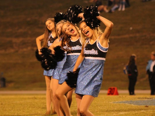 Emily Greenwell and Savannah Horton (front) make faces during their half-time dance performance.