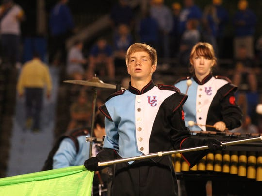 Carson O'Guin prepares to throw his flag for part of the band half-time show.