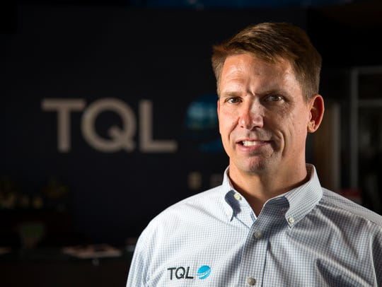 Ken Oaks, CEO of TQL, poses in the lobby of the company's