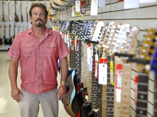 Bill Marinella, owner of Freehold Music, with instruments in his store on Route 9 in Freehold Township.