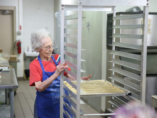Kathleen Talantis, 94, helps fellow parishioners bake