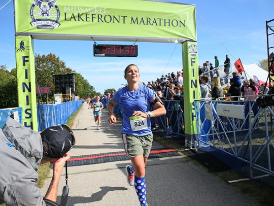 Grace Kassander finishes the Lakefront Marathon in