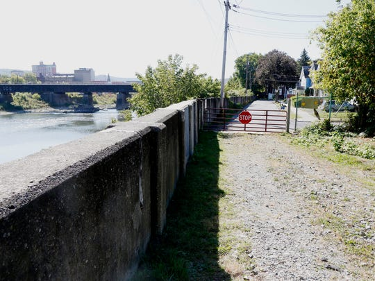 The flood wall that protects McDonald Avenue from the Chenango River in the City of Binghamton on Thursday October 3, 2017. In September, 2011 the Chenango River breached the top of the flood wall.