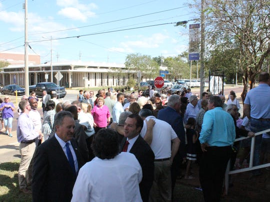 A crowd mingles outside the new Joey Giordano Special Victims Department in downtown Alexandria on Wednesday. The building was open for tours after the ribbon cutting.