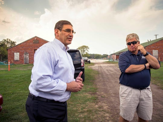 Des Moines Councilman Joe Gatto, left, and Blank Park Zoo CEO Mark Vukovich, right, tour the Fort Des Moines site Monday, Sept. 18, 2017.  Des Moines wants tear down three deteriorating buildings at Fort Des Moines where, 100 years ago this month, the country graduated its first class of black officers in the U.S. Army.