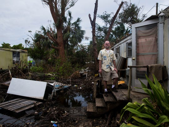 Darren Kingston stands outside of his mobile home,
