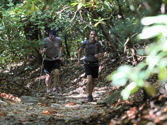 Ed McDaniel, left, and Sam Moore begin their ascent up Lookout Mountain in a training run before the Lookout to Lookout to Lookout race Oct. 14.