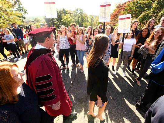 Dr. Anthony J. Iacono and family get a warm welcome from students during the procession into his Inauguration as the third president of the County College of Morris. October 6, 2017. Randolph, New Jersey