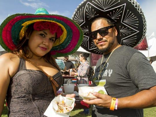 Gabriella Arias and Carlos Bello get tacos from Taco