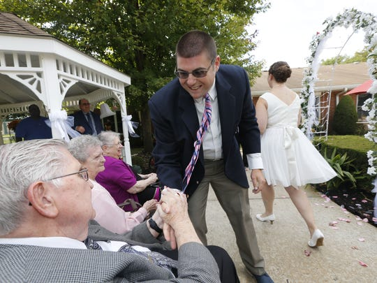 Tom DiPaolo greets bride Ellen Tyndell's grandparents, Louis and Catherine Tyndell, after the ceremony.